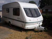 Elddis Huricane XL 2 berth caravan for sale, year 2000 with awning.