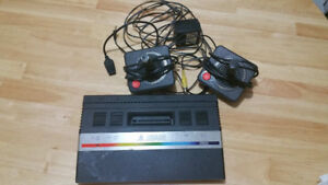 Atari 2600 and 50 games, 2 controllers and hookup to newer tvs!