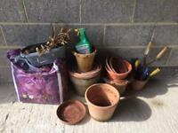 Flower pots and bag of soil