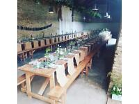 Wooden trestle tables and benches for weddings