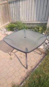 Outdoor glass table and 6 chairs