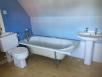 White Fordham Bathroom suite inc. Bath with panels, sink, toilet