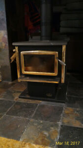 Wood Stove  OSBURN with ceramic door and gold leaf