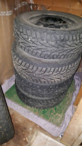 215/65r15 winter tires on rims for sale. only used for 1 season