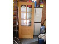 Internal wooden door with glass panels.