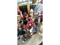32 clay dolls