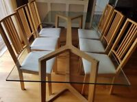 Large glass dining room table with 6 matching chairs