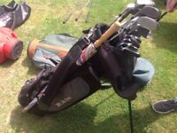 Black Ram Golf Bag with Clubs and Umbrella