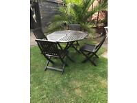 Garden table with four chairs in shoebury
