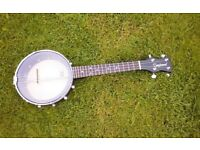 Banjolele. Size of a ukelele. Shape of a banjo.