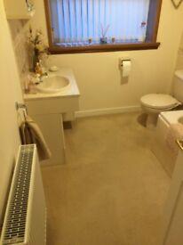Bathroom furniture in light cream colour