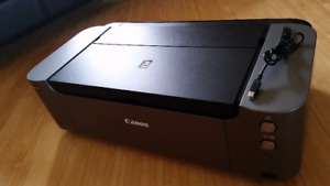 Canon Pro-100, Less Ink, Includes Photo Papers Value at $140