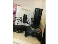 Xbox 360 E 4GB Black. Used, perfect condition. Includes original packaging, cables and controller.