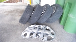 4 steel rims with Winter tires  195 65 15 and caps for toyota