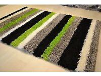 Black and green 8' X 5' stripe shaggy rug