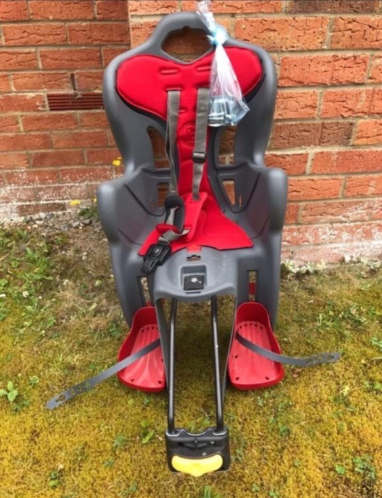 Rear Child Bike Seatin Winnersh, BerkshireGumtree - Rear child bike seat quick and easy to fit with all attachments. Suitable for children older than 9 months up to 22kg. hardly used.Purchased from Halfords.Comes from clean home.Collection only from Winnersh