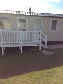 fantastic opportunity to acquire a holiday home on Devon Cliffs award winning park