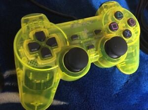 Two Playstation 2 Controllers