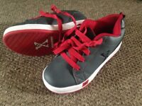 Heeleys by 'Sidewalk Sports'. Size 13. Very good condition/Hardy worn