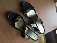 Black and gold size 5 slip ons