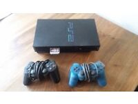 PS2 with Two Controllers - Good condition and perfect working order