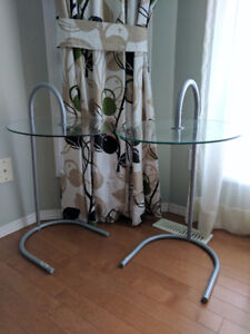 Two IKEA glass side stands. $25 for both. Pickup from Camrose