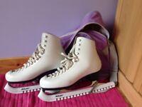 White ice skates, size 40.