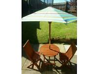 Excellent condition Childs Garden table/chairs/parasol set!