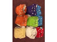 Nine good condition pocket nappies