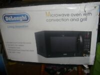 De'Longhi EC925E4X Heavy Duty Combination 900W Touch Microwave Black, returned un wanted gift 25 ltr