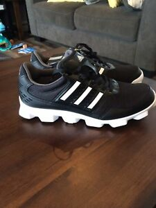 Brand new addidas sneaker cleats 9.5
