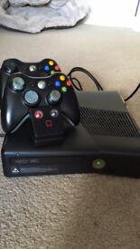 Xbox 360 elite, 2 controllers. Charging dock.
