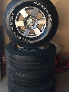 "16"" Nissan rims  and Tires"