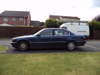BMW 735i year 1998 blue with cream leather