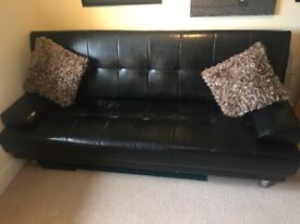 ** Like new - Faux Black leather sofa bed