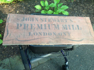 "VINTAGE WOOD SIGN ""JOHN STEWART'S PREMIUM MILL LONDON ONT""."