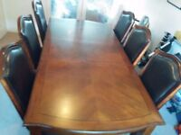 A lovely 8 seater dining table and 6 chair including 2 carvers