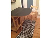 extending kitchen table and four fold away chairs, easy to store, solid wood