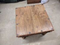 Solid wood coffee table with rod iron accents