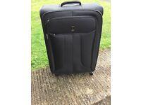 Travelpro expandable large suitcase