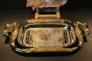 Two tarnish resistant metal serving trays