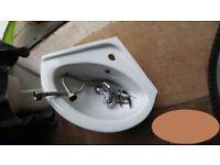 Small corner basin and tap