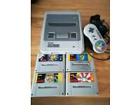 Super Nintendo (no yellowing) 1 pad all leads 4 games