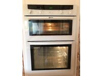 White NEFF U-1442 Built-in Electric Double Oven with instructions