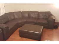 Brown leather corner sofa, armchair and foot stool.