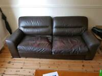 Large 2 seat brown leather sofa