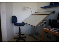 Adjustable drawing board and chair