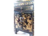 a small Chinese cabinet