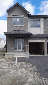 Brand new end unit townhouse is ideally located in Kanata South.