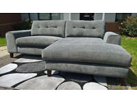 A New Designer 3 Seater Grey Fabric Material Lounger.